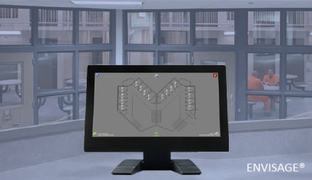 All-in-one computer showing ENVISAGE® overlaid on a photo of the interior of a prison